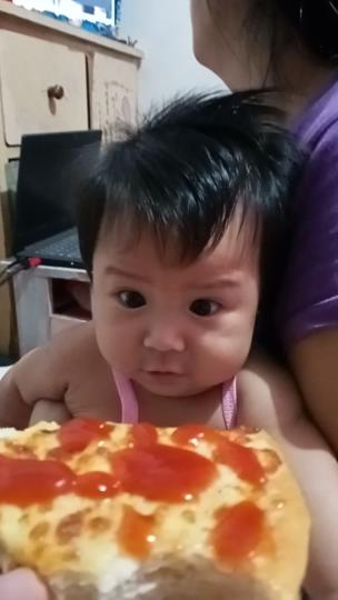 Baby stops crying as soon as she sees pizza collection item