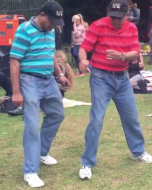 Twin lads dancing at a festival collection item