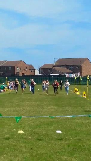 Mums take part in the running race at sports day and the leaders fall over collection item