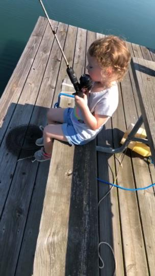 Dad teaches his daughter how to fish collection item