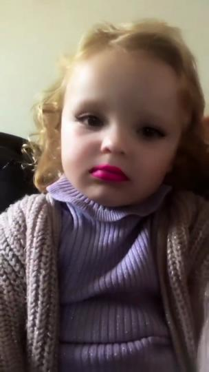 Young girl tries to wipe off lipstick from a snapchat filter on her face collection item