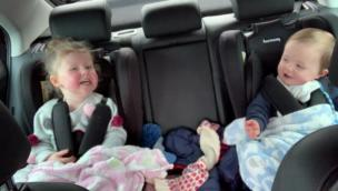 Little sister makes baby brother laugh in car collection item