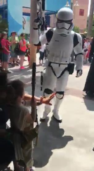 Kid dressed as 'Rey' from 'Star Wars' stands her ground against all the villains collection item