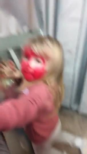 Girl covers whole face in red lipstick collection item
