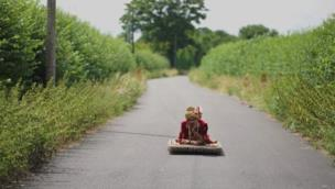 Lad in traditional Indian dress rides a magic carpet to his wedding collection item