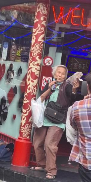 Woman flaunts cash in her hand while drinking a beer collection item