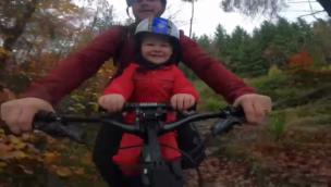Kid can't stop laughing while riding on his Dad's bike collection item