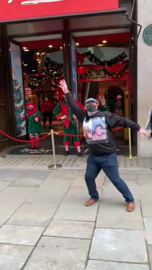 Lad dances with elves outside Hamley's toy shop collection item