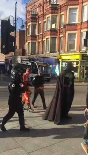 group dressed up as Star wars Darth vader and stormtroopers walking the streets in Devon collection item